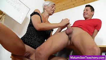 Blond-haired madam giving a oral job