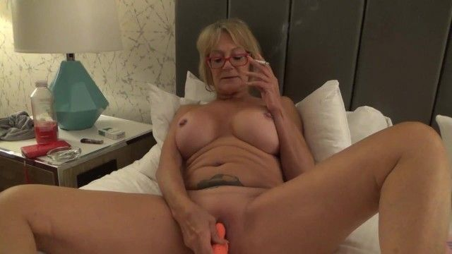 Large tit gigi juggs smokes and plays w myself milf gilf large tits cigarette pierced nipps love button