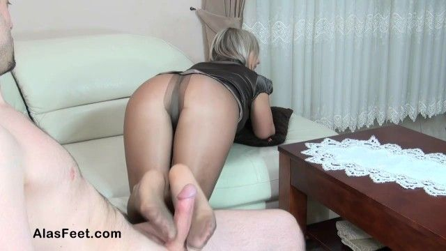 Sexy blond milf in hose gives footjob