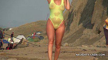 Transparent swimsuit and undressed on the beach