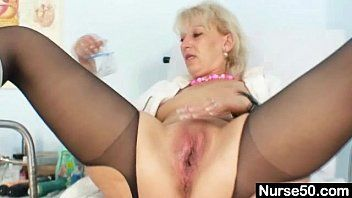 Golden-haired milf in latex uniform bizarre vibrator insertion
