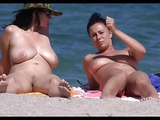 Breasty milfs on beach